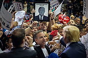 Republican presidential candidate Donald Trump shakes hands with supporters at the conclusion of a campaign rally at the University of South Florida Sun Dome in Tampa, Florida, U.S., February 12, 2016.