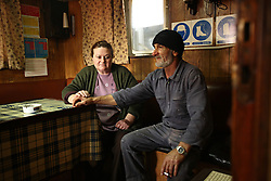 """Greek sailor Theodros Tsikis takes a rest with his wife Chrisanthi Pascalidoy, the ship's cook, onboard the Euripos, a small Greek cargo ship docked in Limassol, Cyprus on Feb. 22, 2008. Cyprus is the crossroads of international ship management and where all the agencies are recruiting and hiring the cheapest workers worldwide. Cyprus is also one of the """"Flag-of-Convenience"""" States like Panama and Liberia."""