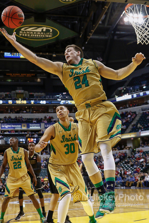 INDIANAPOLIS, IN - DECEMBER  20: Pat Connaughton #24 of the Notre Dame Fighting Irish reaches for the rebound against the Purdue Boilermakers at Bankers Life Fieldhouse on December 20, 2014 in Indianapolis, Indiana. Notre Dame defeated Purdue 94-63. (Photo by Michael Hickey/Getty Images) *** Local Caption *** Pat Connaughton