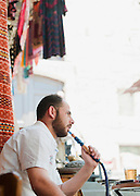 A man smoking a hookah at a cafe in the Old City, Damascus, Syria