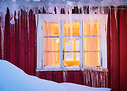 Window in Lofoten, Norway.<br /> ---<br /> Lofoten is an archipelago and a traditional district in the county of Nordland, Norway. Lofoten is known for a distinctive scenery with dramatic mountains and peaks, open sea and sheltered bays, beaches and untouched lands. Though lying within the Arctic Circle, the archipelago experiences one of the world's largest elevated temperature anomalies relative to its high latitude.
