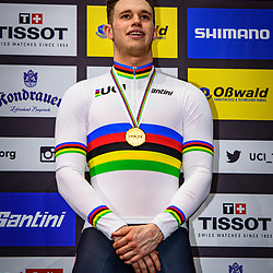 LAVREYSEN Harrie ( NED ) – Netherlands – Winner - First Place - Award Ceremony - Medal Ceremony - Podium - Hochformat - hoch - vertikal - Portrait - Event/Veranstaltung: UCI Track Cycling World Championships 2020 – Track Cycling - World Championships - Berlin - Category/Kategorie: Cycling - Track Cycling – World Championships - Elite Men - Location/Ort: Europe – Germany - Berlin - Velodrom Berlin - Discipline: Sprint - Distance: ... m - Date/Datum: 01.03.2020 – Sunday – Day 5 - Photographer: © Arne Mill - frontalvision.com