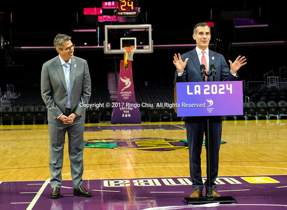 Los Angeles 2024 Chairman Casey Wasserman, left, looks on as Los Angeles Mayor Eric Garcetti, speaks in a news conference at Staples Center, Friday, May 12, 2017, in Los Angeles, the United States. A team of International Olympic Committee delegates wrap up their a three-day tour of Los Angeles as the city attempts to demonstrate its readiness to stage the 2024 Olympics.<br />   (Xinhua/Zhao Hanrong)(Photo by Ringo Chiu/PHOTOFORMULA.com)<br /> <br /> Usage Notes: This content is intended for editorial use only. For other uses, additional clearances may be required.
