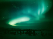 Green auroral display viewed over the Talkeetna Mountains from Tahneta Pass on the night of April 13-14, 2001, Alaska.