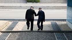 April 27, 2018 - Panmunjom, South Korea - South Korean President MOON JAE-IN meets North Korean leader (DPRK) KIM JONG UN, as he crosses the concrete step and the world's most heavily armed border to greet the South Korean President. particularly heightened tensions between Iran, Israel, and the US. (Credit Image: ? Inter-Korean Press Corps via ZUMA Wire)