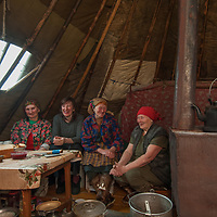 During a rare time to relax north of the Arctic Circle in Russia,  the women of the last nomadic Komi reindeer herding clan gather for tea and biscuits in Marie Terentéva's chum.  Left to Right:  Marie and Katerina Vaucheskaya (ages 72 & 38), Rema Chuprova (70+) & Marie Terentéva (77).