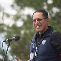 Derrick Terry with Navajo Tribal Utility Authority speaks at the ceremony for the solar panel installation at Forest Lake chapter house Monday.
