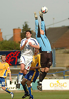 Photo: Leigh Quinnell.<br /> Mansfield Town v Carlisle United. Coca Cola League 2. 22/04/2006. Mansfield goalkeeper Jason White rises high to stop Carlises Derek Holmes.