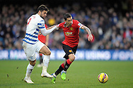Angel Di Maria of Manchester United competing with Charlie Austin of QPR. Barclays Premier league match, Queens Park Rangers v Manchester Utd at Loftus Road in London on Saturday 17th Jan 2015. pic by John Patrick Fletcher, Andrew Orchard sports photography.
