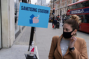 Free hand sanitiser is available for Oxford Street shoppers to maintain personal hygiene, according to government guidelines during the second wave of the UK Coronavirus pandemic, on 30th October 2020, in London, England.