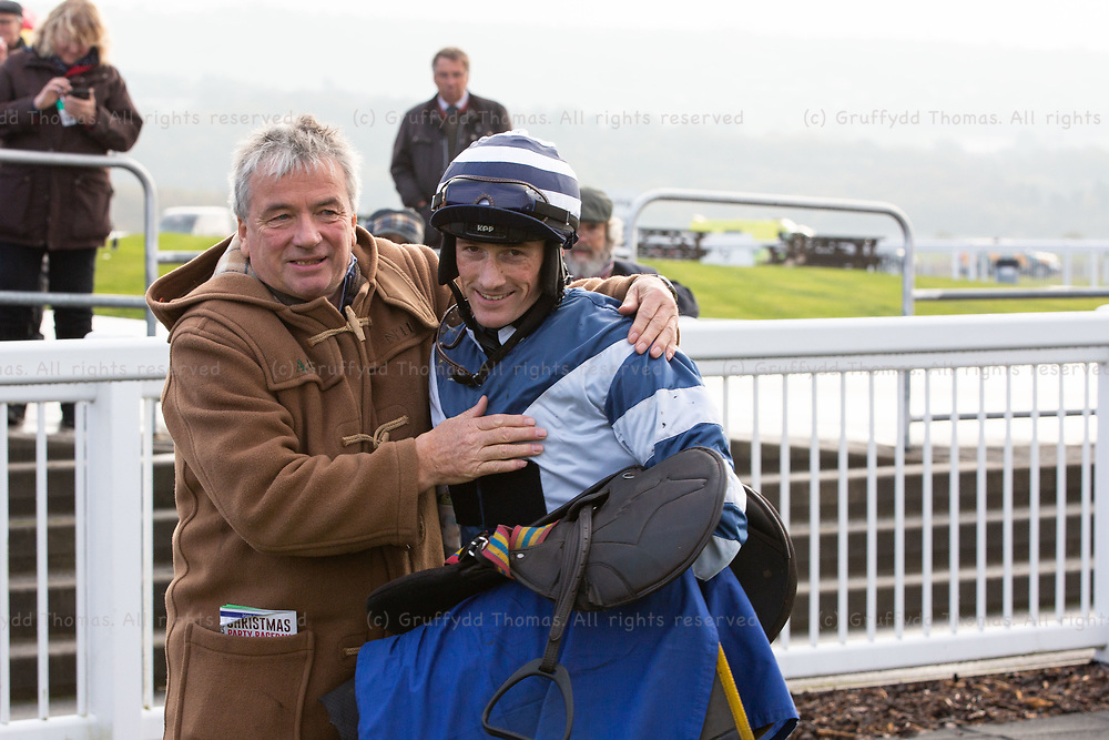 Ffos Las Racecourse, Trimsaran, Wales, UK. Friday 23 November 2018. Race horse trainer Nigel Twiston-Davies with son Nigel, winner of the Pennant Walters Novices' Hurdle (Race 2), riding Al Dancer