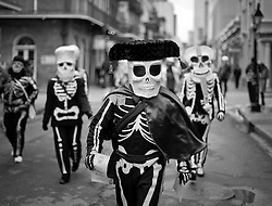 17 Feb 2015. New Orleans, Louisiana.<br /> Mardi Gras Day. Walking with Skeletons. <br /> Entering the French Quarter. The Skeleton Krewe meets before dawn beside a cemetery in Uptown New Orleans. They then walk several miles Along Saint Charles Avenue to the French Quarter to celebrate Mardi Gras Day.<br /> Photo; Charlie Varley/varleypix.com