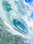 Photographic art design of the inside of a breaking wave.