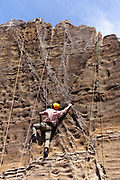 climbing of a vertical rock mountain wall Japan