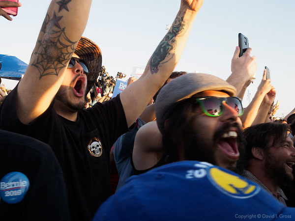 """People cheer Bernie Sanders as he appears on the podium. Thousands of people showed up for a rally in support of Bernie Sanders, a candidate for the Democratic nomination for president, at the """"A Future to Believe In"""" rally in Vallejo, California."""