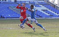 Siriki Dembele of Peterborough United in action with Dan Gardner of Wigan Athletic - Mandatory by-line: Joe Dent/JMP - 27/02/2021 - FOOTBALL - Weston Homes Stadium - Peterborough, England - Peterborough United v Wigan Athletic - Sky Bet League One