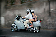 """Person riding a """"Vespa"""" on the way up to Monte Gianicolo, Rome, Italy, Frommer's Italy Day By Day"""