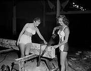 "Ackroyd 00025-19. ""Girls at Sport Show. May 7, 1947"" (bikini-clad girls with saws and woodworking tools)"