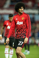 Marouane Fellaini of Manchester United during pre match warm up. The Emirates FA cup, 6th round replay match, West Ham Utd v Manchester Utd at the Boleyn Ground, Upton Park  in London on Wednesday 13th April 2016.<br /> pic by John Patrick Fletcher, Andrew Orchard sports photography.