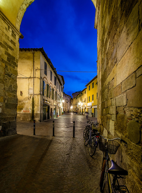 LUCCA ITALY - CIRCA MAY 2015: Street in the old walled city of Lucca at night, an historic town in Tuscany