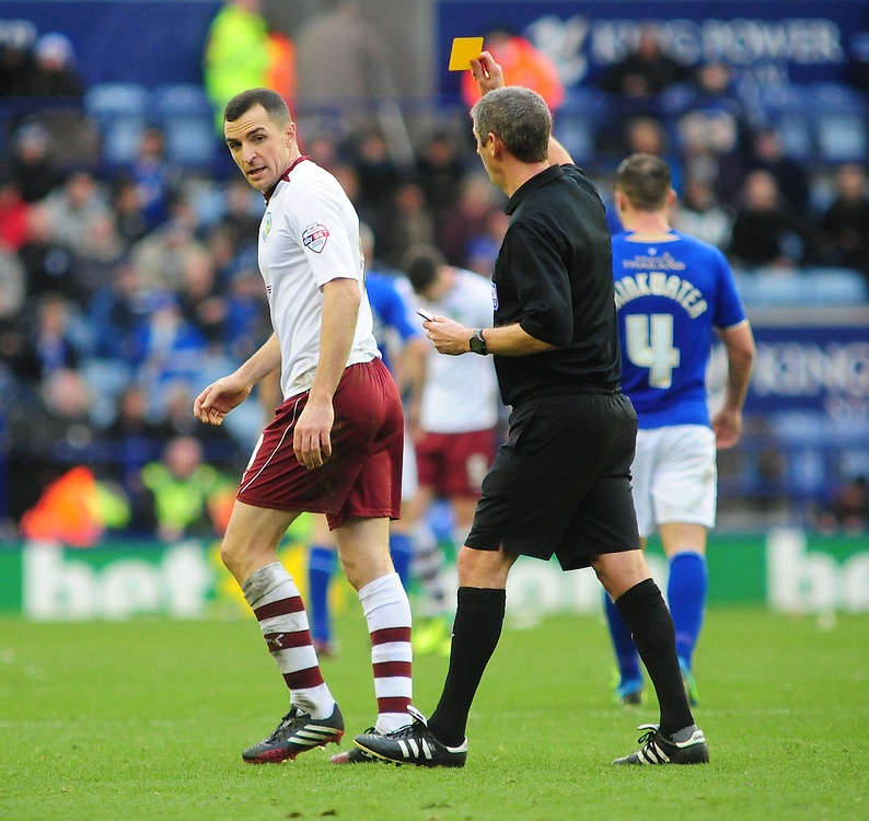 Burnley's Dean Marney is shown a yellow card by Referee Andy D'Urso <br /> <br /> Photo by Chris Vaughan/CameraSport<br /> <br /> Football - The Football League Sky Bet Championship - Leicester City v Burnley - Saturday 14th December 2013 - King Power Stadium - Leicester<br /> <br /> © CameraSport - 43 Linden Ave. Countesthorpe. Leicester. England. LE8 5PG - Tel: +44 (0) 116 277 4147 - admin@camerasport.com - www.camerasport.com