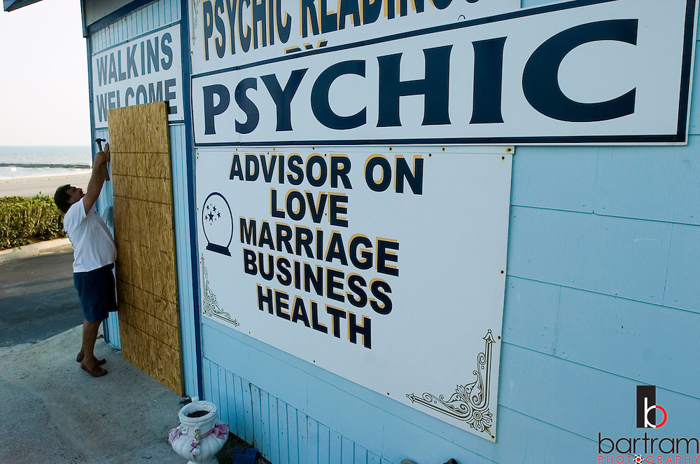 Barney Adams boards up his business, Island Psychic, in Galveston, Texas on Wednesday, Sept. 21, 2005 as Hurricane Rita approaches. Adams' wife, psychic Mary Adams, predicts that Galveston will not suffer major damage. (The Galveston County Daily News, Kevin Bartram)
