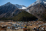 A village seen in the Kinnaur valley with mountains towering above, 20th October 2009, Himachal Pradesh, India. The region of Spiti and Kinnaur is a remote and tribal area of the Indian Himalayas near the Tibetan border.