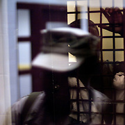 "A detainee looks out of a cell past the reflection of a US military official seen on a security window in Camp 5, which is a maximum-security detention facility where the most uncooperative as well as detainees with the most intelligence value are housed at the detention facility in Guantanamo Bay, Cuba. Approximately 250 ""unlawful enemy combatants"" captured since the September 11, attacks on the United States continue to be held at the detention facility. (Image reviewed by military official prior to transmission)"