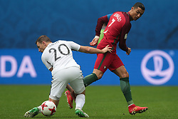 June 24, 2017 - Saint Petersburg, Russia - Tommy Smith (L) of the New Zealand national football team and Cristiano Ronaldo of the Portugal national football team vie for the ball during the 2017 FIFA Confederations Cup match, first stage - Group A between New Zealand and Portugal at Saint Petersburg Stadium on June 24, 2017 in St. Petersburg, Russia. (Credit Image: © Igor Russak/NurPhoto via ZUMA Press)