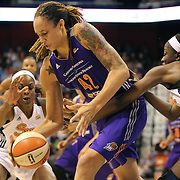 Brittney Griner, (left), Phoenix Mercury, is defended by Chiney Ogwumike, Connecticut Sun, during the Connecticut Sun Vs Phoenix Mercury WNBA regular season game at Mohegan Sun Arena, Uncasville, Connecticut, USA. 12th June 2014. Photo Tim Clayton
