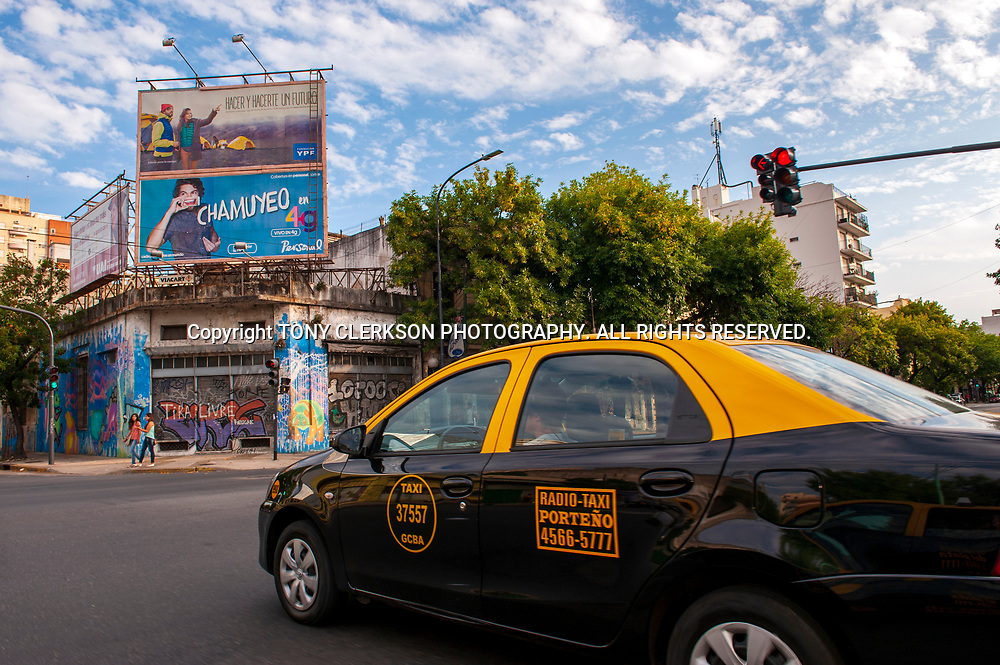 A taxi drives through the Palermo area of Buenos Aires.