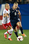 FRISCO, TX - JANUARY 31:  Whitney Engen #6 of the U.S. Women's National Team controls the ball against the Canadian Women's National Team on January 31, 2014 at Toyota Stadium in Frisco, Texas.  (Photo by Cooper Neill/Getty Images) *** Local Caption *** Whitney Engen