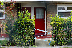 © Licensed to London News Pictures. 26/03/2021. London, UK. Police tape around the gate of a residential property in Kent Street in Newham, East London following death of an elderly woman. Police were called just after 10pm on Thursday, 25 March and found the 76-year-old woman dead. A man aged in his 30s was arrested at the scene on suspicion of murder and remains in police custody. Photo credit: Dinendra Haria/LNP