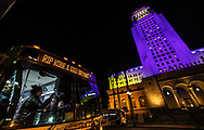 Landmarks and buildings light up in purple and gold, the official Laker Basketball team colors, to commemorate Kobe Bryant who was killed in a helicopter crash.<br /> L.A. City Hall Building.<br /> Los Angeles, CA USA <br /> (Photo by Ted Soqui)