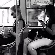 Asking myself why the image is not in color ?!_ #prag #praha #Prague #czechrepublic #phone #mobile #smart #telephone #tram #transport #publictransport #identical #passengers #tram #9