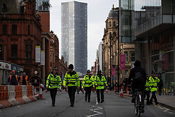© Licensed to London News Pictures. 30/08/2019. Manchester, UK. Police on a traffic-free Deansgate . Extinction Rebellion block roads during the rush hour , in Manchester City Centre , at the start of several days of planned disruption organised by environmental campaigners . Manchester City Council has declared a climate emergency but activists say the council's development plans do not reflect this . Photo credit: Joel Goodman/LNP