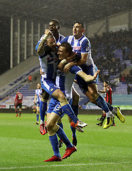 Wigan Athletic's Dan Burn (bottom right) celebrates scoring his side's second goal of the game during the Emirates FA Cup, Third Round Replay at the DW Stadium, Wigan.