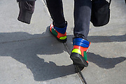 close up of a person with colorful sneakers