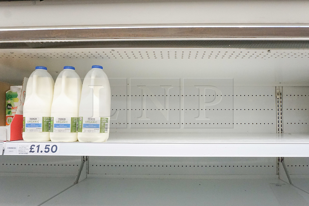 © Licensed to London News Pictures. 21/09/2020. Sheffield, UK. Plastic bottles of milk nearly sold out in Tesco supermarket in Sheffield. In supermarkets across the country,  there is a fear that the second wave of the pandemic is approaching, after a spike in coronavirus cases in the UK. Photo credit: Ioannis Alexopoulos/LNP