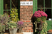 Colorful pots of flowers outside shops in Toronto's DIstillery District.