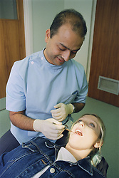 Dental examination or check up by dental officer,