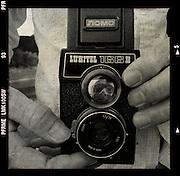 Close up of photographer holding a camera