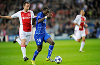 FOOTBALL - CHAMPIONS LEAGUE 2010/2011 - GROUP STAGE - GROUP G - AJAX AMSTERDAM v AJ AUXERRE - 19/10/2010 - PHOTO GUY JEFFROY / DPPI - DENNIS OLIECH (AUX) / ANDRE OOIJER (AJAX)