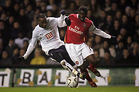 Photo: Paul Thomas.<br /> Tottenham Hotspur v Arsenal. Calring Cup, Semi Final 1st Leg. 24/01/2007.<br /> <br /> Kolo Toure (R) of Arsenal tries to get past Pascal Chimbonda.