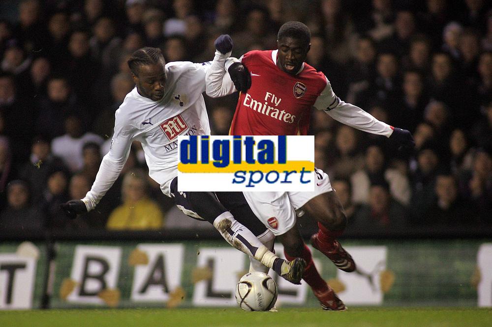 Photo: Paul Thomas.<br /> Tottenham Hotspur v Arsenal. Calring Cup, Semi Final 1st Leg. 24/01/2007.<br /> <br /> Kolo Toure (R) of Arsenal tries to get past Pascal Chimbonda.