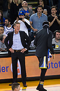 Golden State Warriors head coach Steve Kerr laughs after Golden State Warriors guard Stephen Curry (30) makes a near-mid-court three pointer at the buzzer of the first quarter against the LA Clippers at Oracle Arena in Oakland, California, on February 22, 2018. (Stan Olszewski/Special to S.F. Examiner)