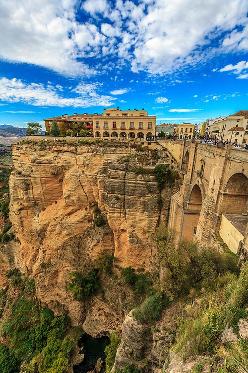 The New Bridge (Puente Nuevo) and Parador Hotel in Ronda, Spain. The bridge dramatically crosses the El Tajo canyon.