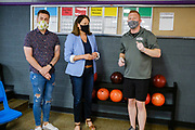 14 JULY 2020 - ADEL, IOWA: THERESA GREENFIELD, center, talks to KALE SMITH, left, and BRIAN SMITH, right, about the health protocols they are using at the Adel Family Fun Center, a bowling alley Brian Smith owns in Adel, IA, about 25 miles west of Des Moines. Theresa Greenfield, a Democrat, is running for the US Senate against incumbent Senator Joni Ernst. Recent polls have Greenfield slightly ahead of or statistically tied with Ernst, who is closely allied with President Donald Trump. This was one of Greenfield's first live campaign events since the Coronavirus pandemic shutdown started in March. She has been campaigning virtually using teleconferencing apps.      PHOTO BY JACK KURTZ