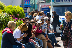 Tourists rest in the sunshine at Jubilee Gardens near the London Eye. London, May 09 2018.