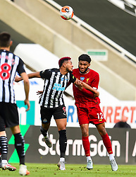 LIVERPOOL, ENGLAND - Sunday, July 26, 2020: Liverpool's Joe Gomez (R) challenges for a header with Joelinton Cássio Apolinário de Lira during the final match of the FA Premier League season between Newcastle United FC and Liverpool FC at St. James' Park. The game was played behind closed doors due to the UK government's social distancing laws during the Coronavirus COVID-19 Pandemic. Liverpool won 3-1 and finished the season as Champions on 99 points. (Pic by Propaganda)